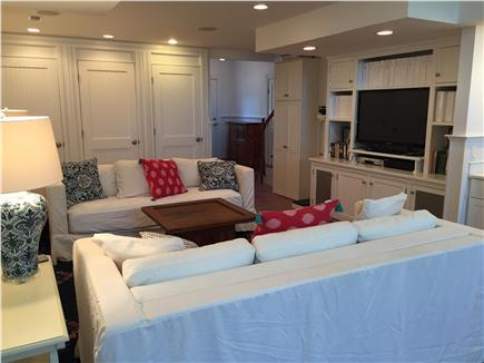 West Yarmouth Cape Cod vacation rental - Family room w/TV, bathroom, two twin daybeds, and access to patio