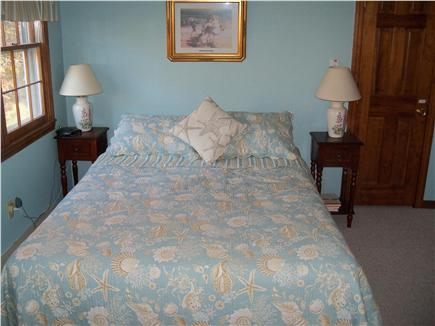Eastham Cape Cod vacation rental - Upstairs bedroom with queen bed and a window AC unit