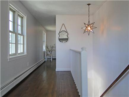 Barnstable Harbor Cape Cod vacation rental - Staircase from living room down to 2 bedrooms
