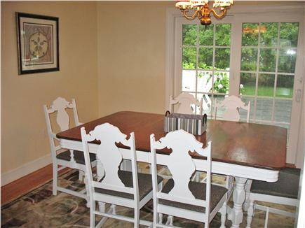West Dennis Cape Cod vacation rental - Dining room off of the kitchen with sliders to the back deck