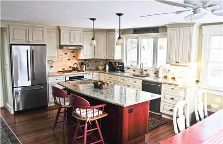 Chatham Cape Cod vacation rental - Loveseat in kitchen and door to 1st floor deck/sitting area.