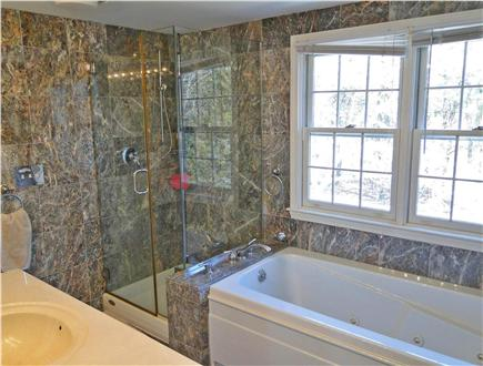 Yarmouth Cape Cod vacation rental - Master bathroom with Jacuzzi tub, walk in shower