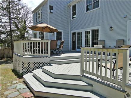 Yarmouth Cape Cod vacation rental - Sunny deck area with seating, grill, outdoor shower