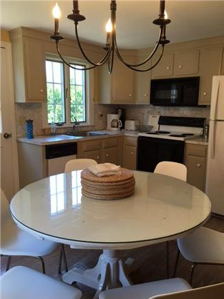 Harwichport Cape Cod vacation rental - Dining area in kitchen and back door