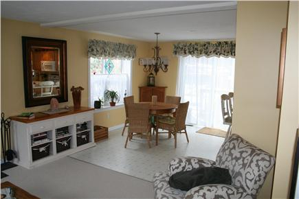 Mashpee Cape Cod vacation rental - Partial view of main floor living and dining area