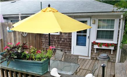 So. Yarmouth Cape Cod vacation rental - 1st outdoor deck with table and six chairs