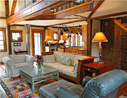 East Orleans Cape Cod vacation rental - Living area with stone fireplace, opens to kitchen