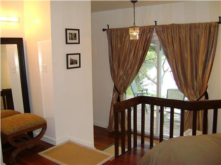 Chatham, Cape Cod Cape Cod vacation rental - Master bedroom with king bed, access to deck & water views