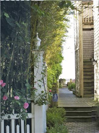 Provincetown Cape Cod vacation rental - Walkway to common waterfront deck and garden