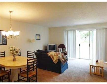 Ocean Edge, Brewster Cape Cod vacation rental - Living/Dining area opens up to patio with grill