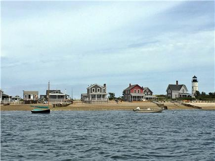 Barnstable Cape Cod vacation rental - View of Sandy Neck homes and lighthouse across the bay