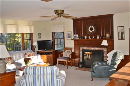 Barnstable Cape Cod vacation rental - Spacious great room with gas fireplace and dining table