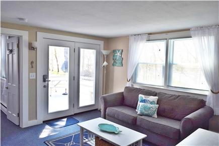Barnstable, Coast of Hyannis Cape Cod vacation rental - Spacious Living Room with a hinged door out to the deck.