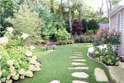 Eastham Cape Cod vacation rental - Nicely landscaped gathering area with portable fire pit