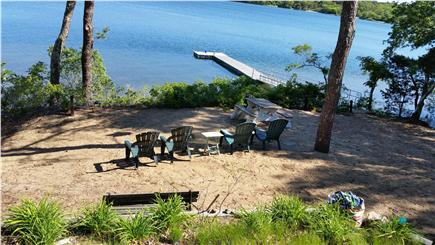 Pleasant Lake Harwich Cape Cod vacation rental - Spacious private beach w/ picnic table, grill, dock, boats & more