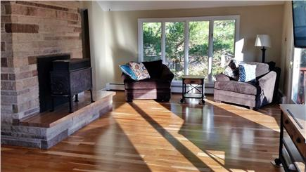 Pleasant Lake Harwich Cape Cod vacation rental - More Family Room seating with stone fireplace overlooking lake