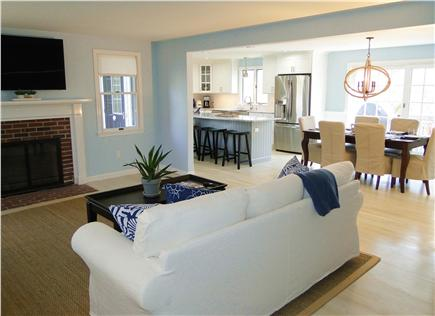 Harwich Cape Cod vacation rental - Living room opens to dining and kitchen areas