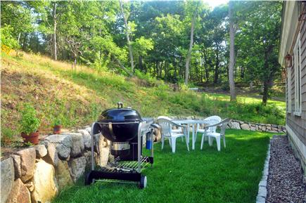 Truro Cape Cod vacation rental - Rear Patio - equipped with a gas grill and dinning for four.