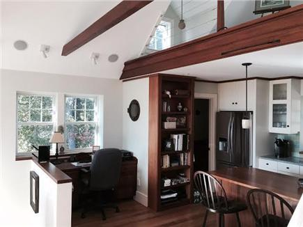 East Orleans Cape Cod vacation rental - View of Desk Area/Half Bath/Kitchen and Loft From Family Room