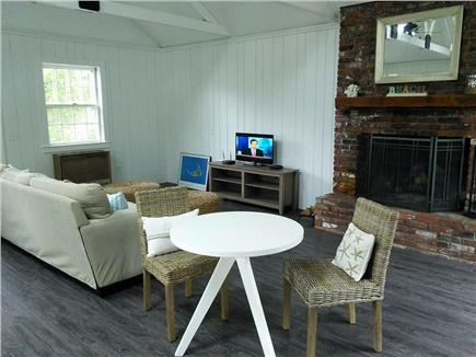 Dennis Port Cape Cod vacation rental - Family room has fire place and cable tv.