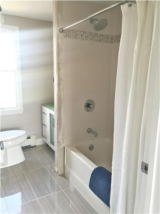 Dennis Port Cape Cod vacation rental - Renovated bathroom w/ custom tiled shower (has cellular shade)