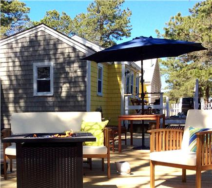 West Dennis Cape Cod vacation rental - Looking from water to cottage and deck area