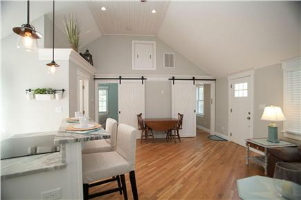 West Yarmouth Cape Cod vacation rental - Custom barn-style bedroom doors shown from living room.