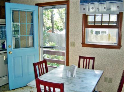South Dennis Cape Cod vacation rental - Feel summer breezes in the eat-in kitchen, with access to deck.
