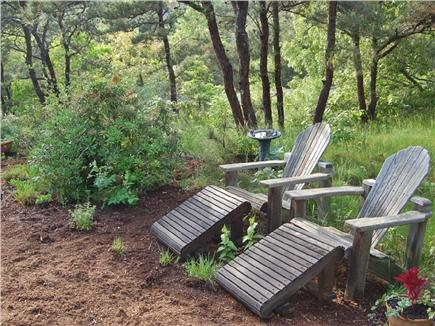 Truro Cape Cod vacation rental - One of many seating areas in gardens. Only the birds can see you!