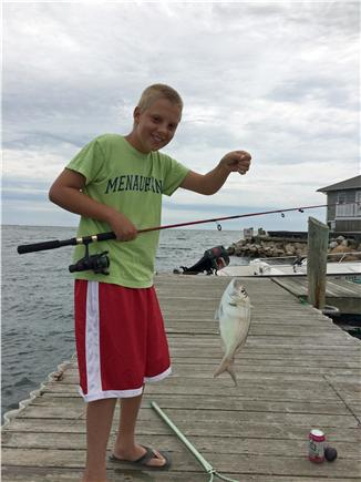 Falmouth, Menauhant Cape Cod vacation rental - Good catch!  Happy kid!