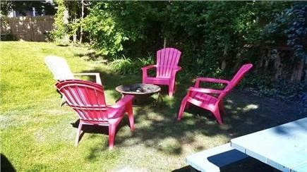 South Yarmouth Cape Cod vacation rental - Side yard with chiminea