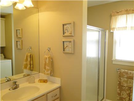 Mashpee, Popponesset Cape Cod vacation rental - Main floor bathroom with shower, laundry
