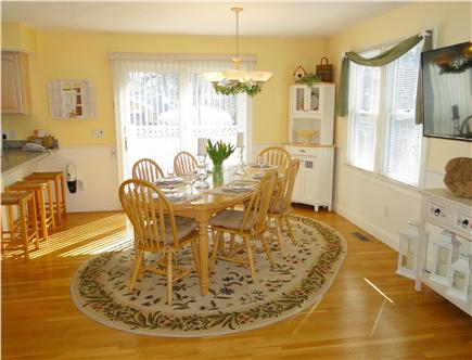 Mashpee, Popponesset Cape Cod vacation rental - Dining area with flat screen TV, slider to deck