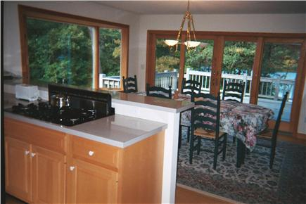 Harwich Cape Cod vacation rental - Open kitchen/dining room w/deck access and pond views