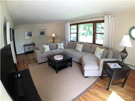 Falmouth Cape Cod vacation rental - Living Room with Large TV and Slider to Deck