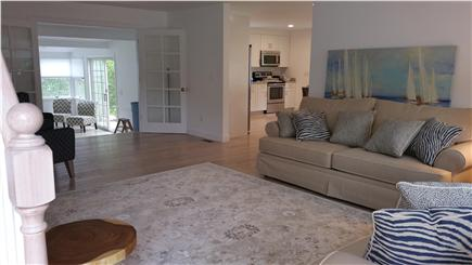 Harwichport Cape Cod vacation rental - Newly remodeled living room looking into kitchen and sunroom