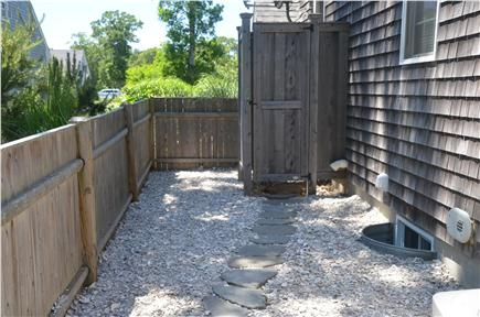 North Eastham Cape Cod vacation rental - Outdoor shower with crushed seashells and stone walkway