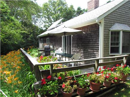 Brewster Cape Cod vacation rental - Back deck with gas grill and picnic table.