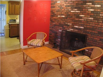 Brewster Cape Cod vacation rental - Family room with tv and fireplace.