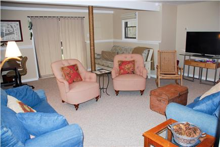 Eastham Cape Cod vacation rental - Downstairs family room has large TV, desk, futon & slider to yard