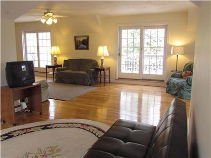 Brewster Cape Cod vacation rental - Spacious L-shaped rec room, sliding doors to second floor decks.
