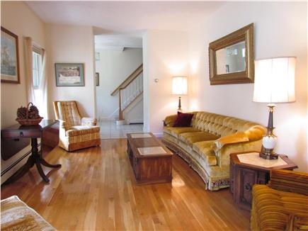 Brewster Cape Cod vacation rental - Living room and front hall and stairs.