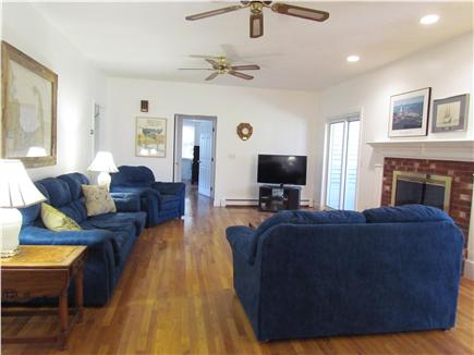 Brewster Cape Cod vacation rental - Family room with fireplace, flat scrn. tv, sliding doors to porch