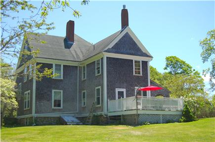 Barnstable Cape Cod vacation rental - Back of house with back deck featuring lots of seating and grill.