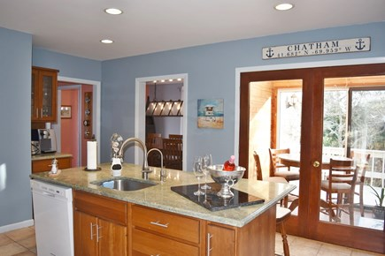 Chatham Cape Cod vacation rental - Well stocked kitchen is open to the sunroom. Plenty of pots pans