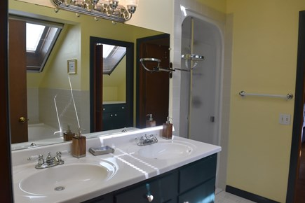 Chatham Cape Cod vacation rental - Upper level bathroom has double sink shower, tub,WC and skylights