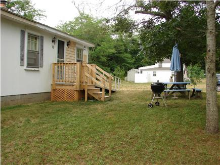 Eastham Cape Cod vacation rental - Street side with picnic table & benches and charcoal grill