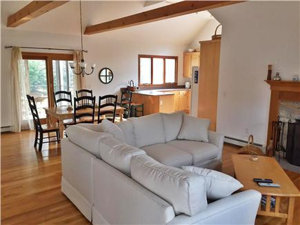 North Eastham Cape Cod vacation rental - Open living room leads to kitchen and to the screened in porch.