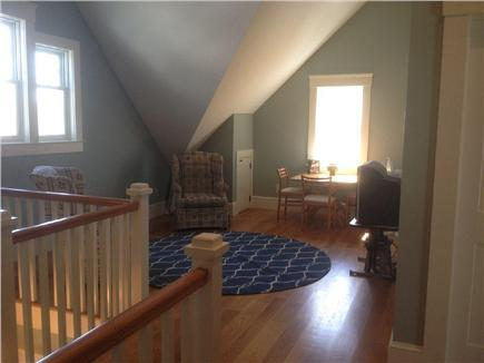 West Yarmouth Cape Cod vacation rental - 2nd floor main loft area with TV, game table, and wet bar