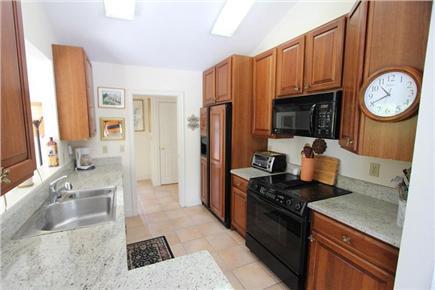 Barnstable Cape Cod vacation rental - Galley Kitchen w/ Granite